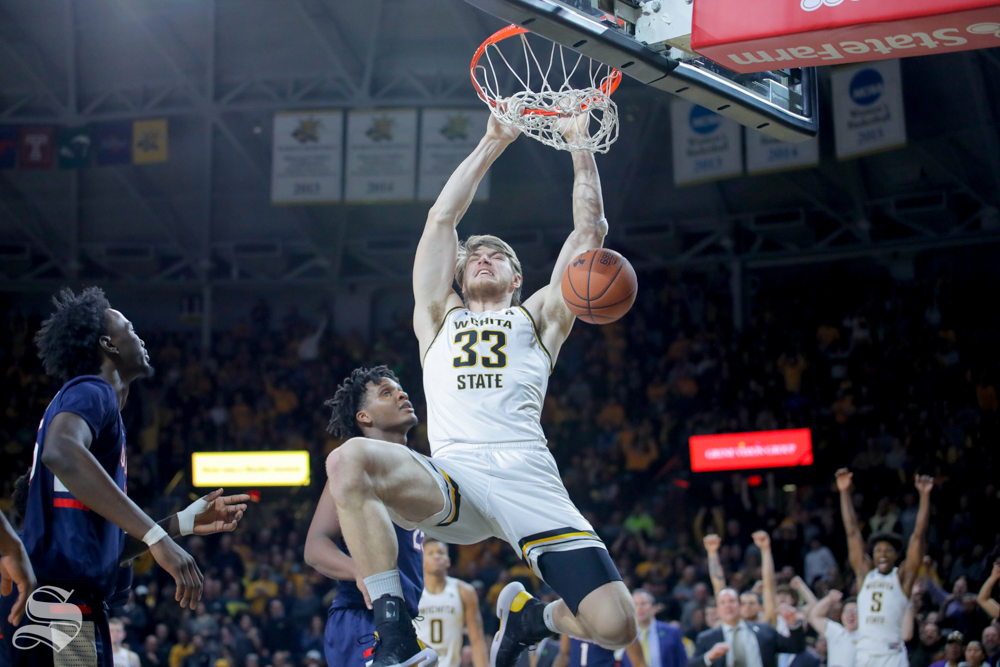 Wichita+State+center+Asbj%C3%B8rn+Midtgaard+makes+a+dunk+in+the+second+half+of+the+game+against+UConn+on+Feb.+28%2C+2019+at+Charles+Koch+Arena.+%28Photo+by+Joseph+Barringhaus%2FThe+Sunflower.%29