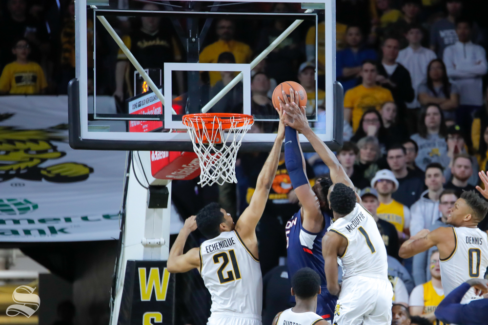Wichita+State+surrounds+a+UConn+player+in+the+second+half+of+the+game+against+UConn+on+Feb.+28%2C+2019+at+Charles+Koch+Arena.+%28Photo+by+Joseph+Barringhaus%2FThe+Sunflower.%29