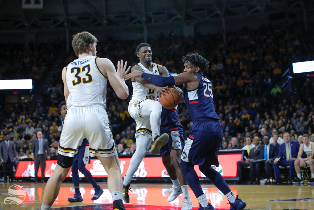 Wichita+State+guard+Jamarius+Burton+is+fouled+by+UConn+forward+Josh+Carlton+in+the+second+half+of+the+game+against+UConn+on+Feb.+28%2C+2019+at+Charles+Koch+Arena.+%28Photo+by+Joseph+Barringhaus%2FThe+Sunflower.%29