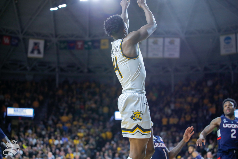 Wichita+State+guard+Samajae+Haynes-Jones+takes+the+final+shot+of+the+game+against+UConn+on+Feb.+28%2C+2019+at+Charles+Koch+Arena.+Haynes-Jones+sank+the+buzzer+beater+against+UConn%2C+sealing+Gregg+Marshall%27s+300th+win.+%28Photo+by+Joseph+Barringhaus%2FThe+Sunflower.%29