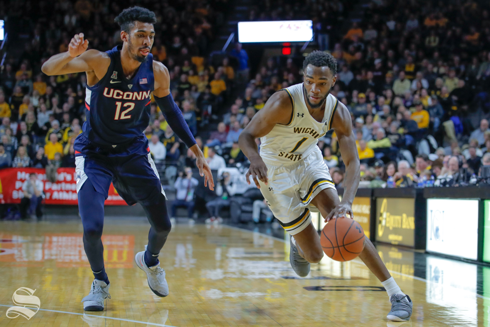 Wichita+State+forward+Markis+McDuffie+dribbles+past+UConn+forward+Tyler+Polley+during+the+game+on+Feb.+28%2C+2019+at+Charles+Koch+Arena.+%28Photo+by+Joseph+Barringhaus%2FThe+Sunflower.%29