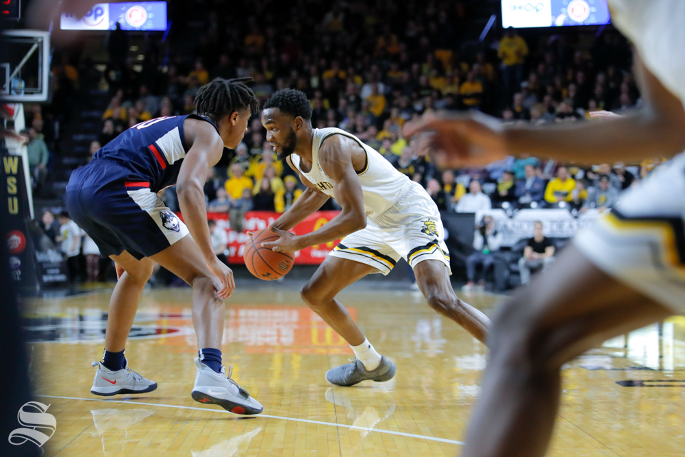 Wichita+State+forward+Markis+McDuffie+dribbles+past+UConn+defense+during+the+game+on+Feb.+28%2C+2019+at+Charles+Koch+Arena.+%28Photo+by+Joseph+Barringhaus%2FThe+Sunflower.%29