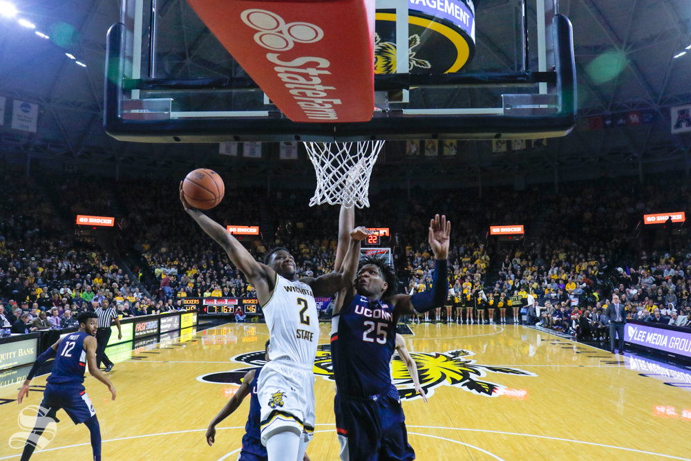 Wichita State guard Jamarius Burton goes up for a dunk in the second half of the game against UConn on Feb. 28, 2019 at Charles Koch Arena. (Photo by Joseph Barringhaus/The Sunflower.)