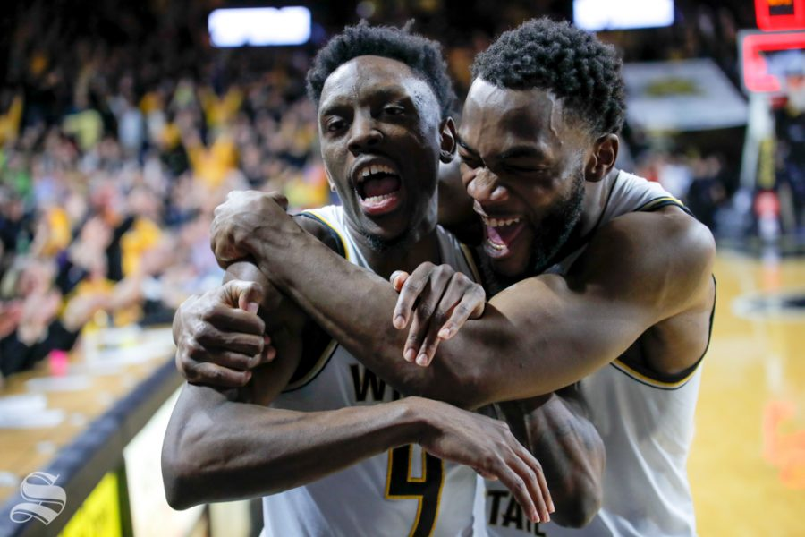 Wichita+State+senior+Markis+McDuffie+hugs+and+celebrates+with+senior+Samajae+Haynes-Jones.+McDuffie+told+Haynes-Jones+to+%22sit+down%22+on+the+couch+that+sits+courtside+after+scoring+the+buzzer+beater+against+UConn.+%28Photo+by+Joseph+Barringhaus%2FThe+Sunflower%29.