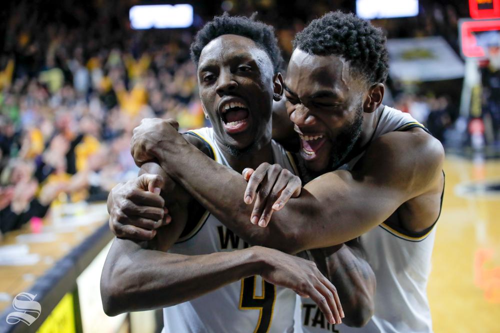 Wichita State senior Markis McDuffie hugs and celebrates with senior Samajae Haynes-Jones. McDuffie told Haynes-Jones to