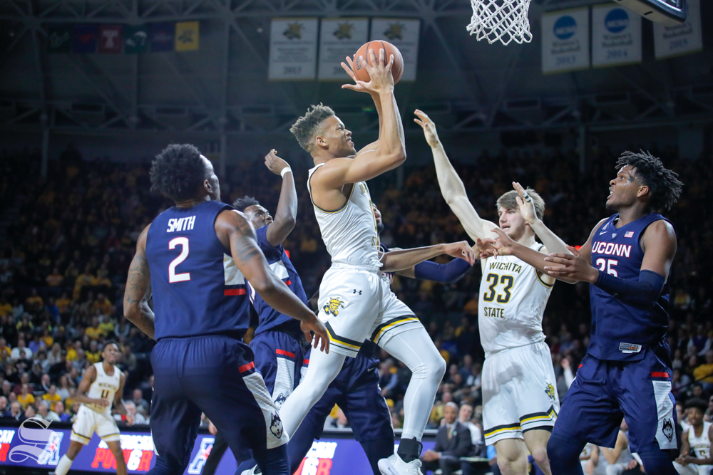 Wichita+State+guard+Dexter+Dennis+reaches+up+towards+the+basket++in+the+second+half+of+the+game+against+UConn+on+Feb.+28%2C+2019+at+Charles+Koch+Arena.+%28Photo+by+Joseph+Barringhaus%2FThe+Sunflower.%29