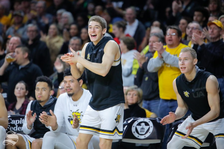 Wichita State guard Jacob Herrs celebrates from the bench in the second half of the game against UConn on Feb. 28, 2019 at Charles Koch Arena. (Photo by Joseph Barringhaus/The Sunflower.)