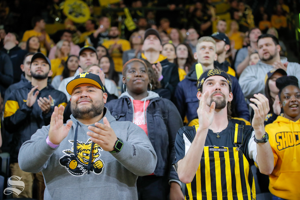 Fans+clap+and+cheer+before+the+start+of+the+game+against+UConn+on+Feb.+28%2C+2019+at+Charles+Koch+Arena.+%28Photo+by+Joseph+Barringhaus%2FThe+Sunflower.%29