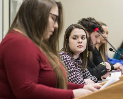 Newly sworn-in Student Body President Shelby Rowell listens to Maia Cuellar speak during open forum of the Student Senate meeting Wednesday, Feb. 13, 2019. Brinkley resigned as Student Body President Wednesday morning amid accusations that he sexually assaulted Cuellar in 2017.