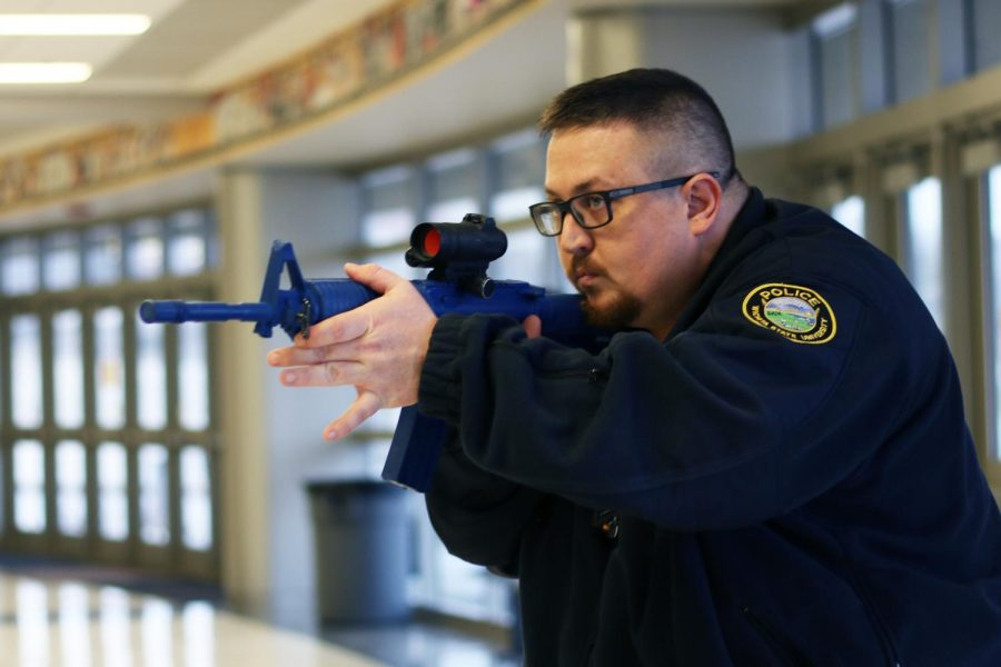 WSUPD officer engaging in active shooter training excercise. This excercise was performed inside Charles Koch arena.
