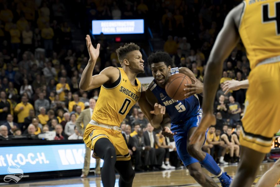Wichita State freshman Dexter Dennis on defense during their game against Memphis on Feb. 23 at Koch Arena.