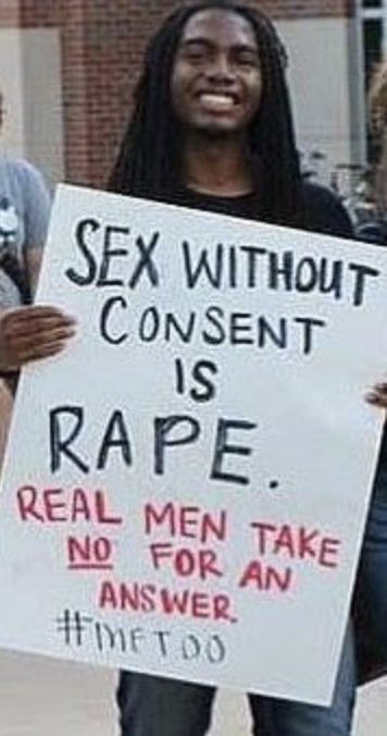 Kenon Brinkley (holding sign) is pictured in this photo from the Walk-a-Mile event. The event is held annually to raise awareness for rape, sexual assault, and gender violence.