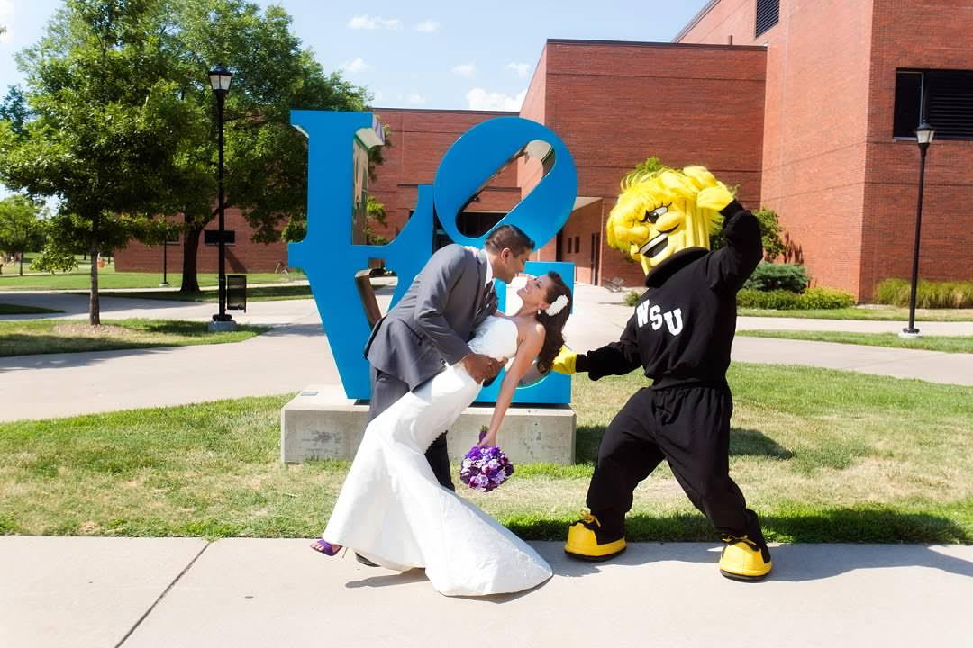 "Trish and Bobby Gandu pose with by Wichita State's ""Love"" sculpture (courtesy)."