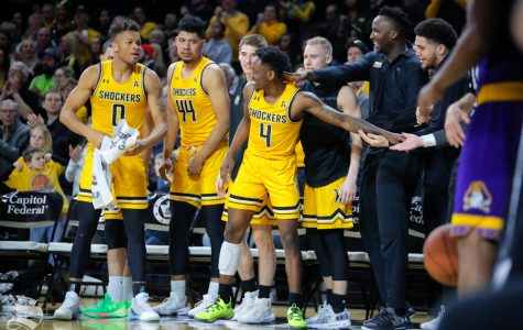 Wichita State senior Samajae Haynes-Jones celebrates with his teammates after stepping off the court at Charles Koch Arena for possibly the last time. Wichita State beat ECU 72-55 on March 5, 2019 at Charles Koch Arena. (Photo by Joseph Barringhaus/The Sunflower.)