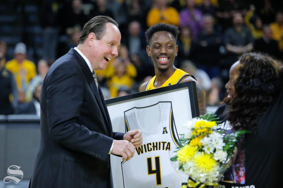 Coach+Gregg+Marshall+speaks+with+Samajae+Haynes-Jones+and+his+sister+after+their+final+game+in+Charles+Koch+Arena+on+March+5%2C+2019.+%28Photo+by+Joseph+Barringhaus%2FThe+Sunflower.%29