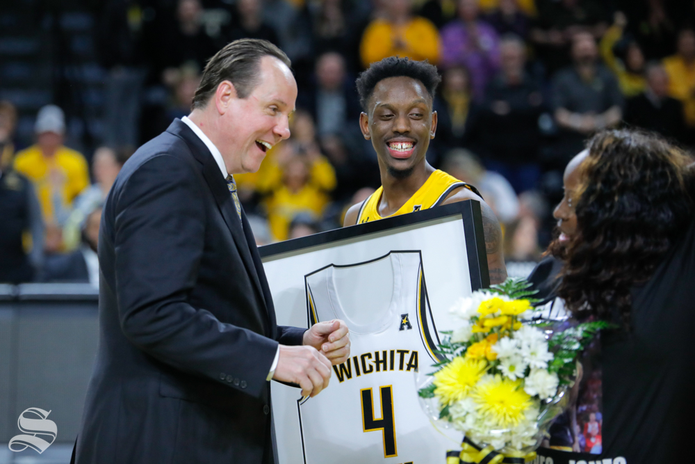 Coach Gregg Marshall speaks with Samajae Haynes-Jones and his sister after their final game in Charles Koch Arena on March 5, 2019. (Photo by Joseph Barringhaus/The Sunflower.)