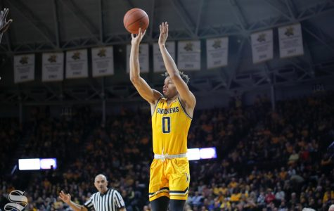 Wichita State guard Dexter Dennis takes a shot during the first half of the game against ECU on March 5, 2019 at Charles Koch Arena. (Photo by Joseph Barringhaus/The Sunflower.)