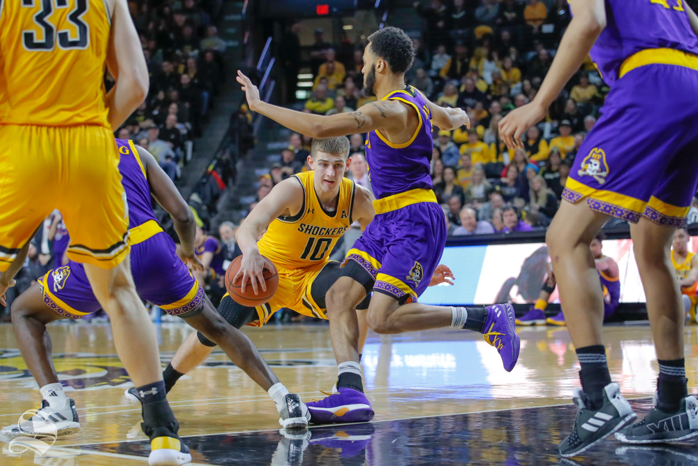 Wichita State guard Erik Stevenson makes a move during the second half of the game against ECU on March 5, 2019 at Charles Koch Arena. (Photo by Joseph Barringhaus/The Sunflower.)