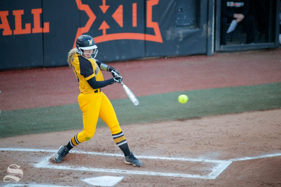 Wichita State junior Ryleigh Buck gets a hit during the game against Oklahoma State University in Stillwater, OK on March 6, 2019. (Photo by Joseph Barringhaus/The Sunflower.)