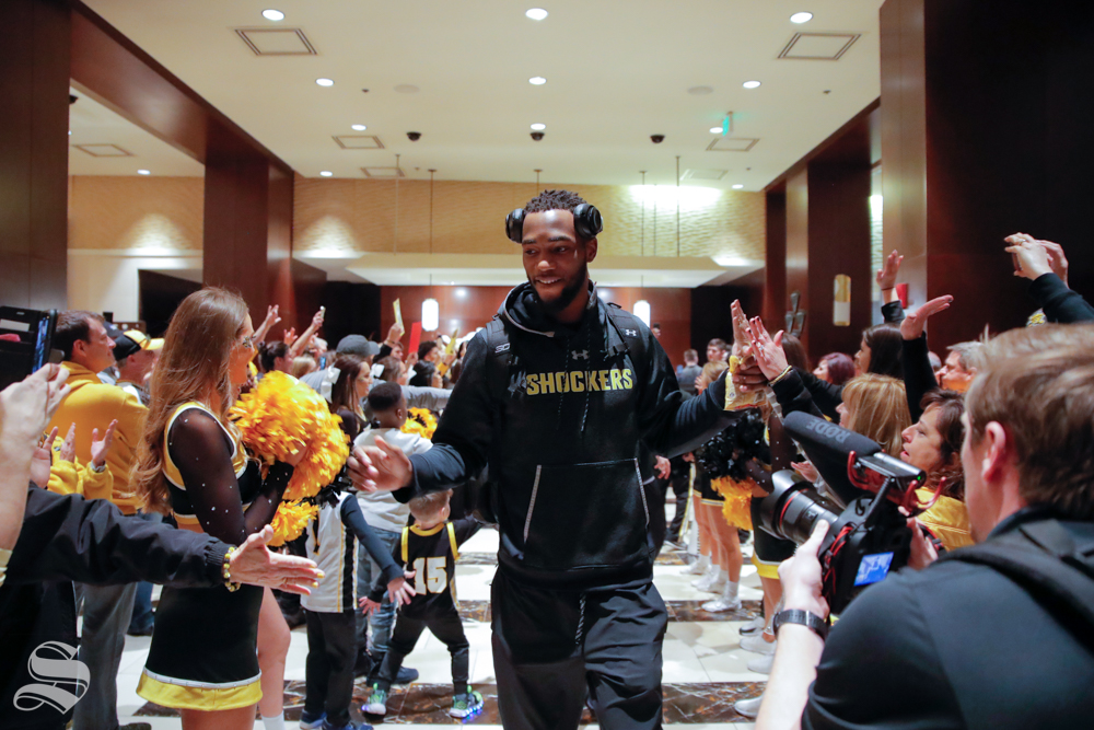 Markis McDuffie walks through the lobby of the team hotel on the way to the game on March 14, 2019. (Photo by Joseph Barringhaus/The Sunflower.)