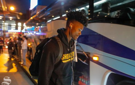 Rod Brown loads up on the bus on the way to the game on March 14, 2019. (Photo by Joseph Barringhaus/The Sunflower.)