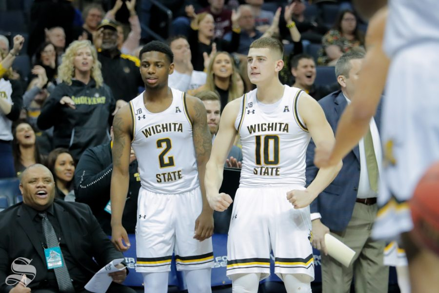 Wichita+State+freshman+Erik+Stevenson+celebrates+a+basket+from+the+bench+during+the+second+half+of+the+game+against+East+Carolina+on+March+14%2C+2019+at+the+FedExForum+in+Memphis%2C+Tennessee.+%28Photo+by+Joseph+Barringhaus%2FThe+Sunflower.%29