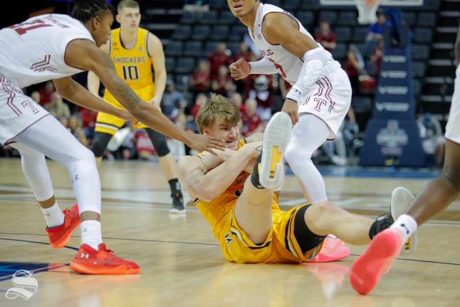 Wichita State forward Asbjørn Midtgaard fights for the ball on the ground during the second half of the game against Temple on March 15, 2019 at the FedExForum in Memphis, Tennessee. (Photo by Joseph Barringhaus/The Sunflower).