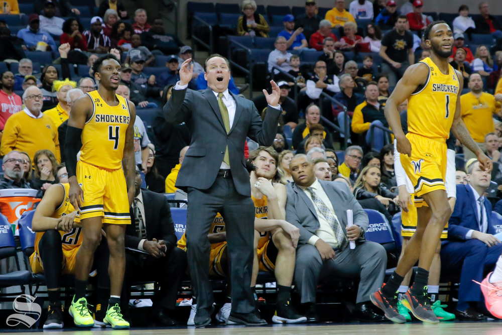 Coach Gregg Marshall and the Shocker bench wait for a shot to drop during the second half of the game against Temple on March 15, 2019 at the FedExForum in Memphis, Tennessee. (Photo by Joseph Barringhaus/The Sunflower).