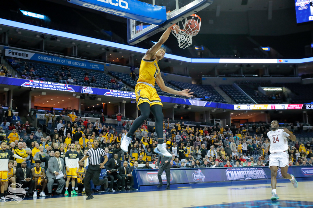 Wichita State guard Dexter Dennis dunks in the final seconds of the second half of the game against Temple on March 15, 2019 at the FedExForum in Memphis, Tennessee. (Photo by Joseph Barringhaus/The Sunflower).