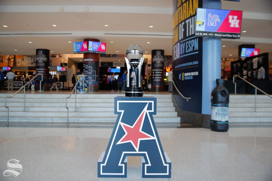 The+American+Athletic+Conference+tournement+trophy+sits+in+the+concourse+of+the+FedExForum+before+Wichita+State%27s+semifinal+game+against+Cincinnati+on+March+16%2C+2019+in+Memphis%2C+Tennessee.