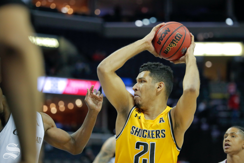 Wichita State forward Jaime Echenique looks for a pass during the second half of the game against Cincinnati on March 16, 2019 at the FedExForum in Memphis, Tennessee. (Photo by Joseph Barringhaus/The Sunflower).