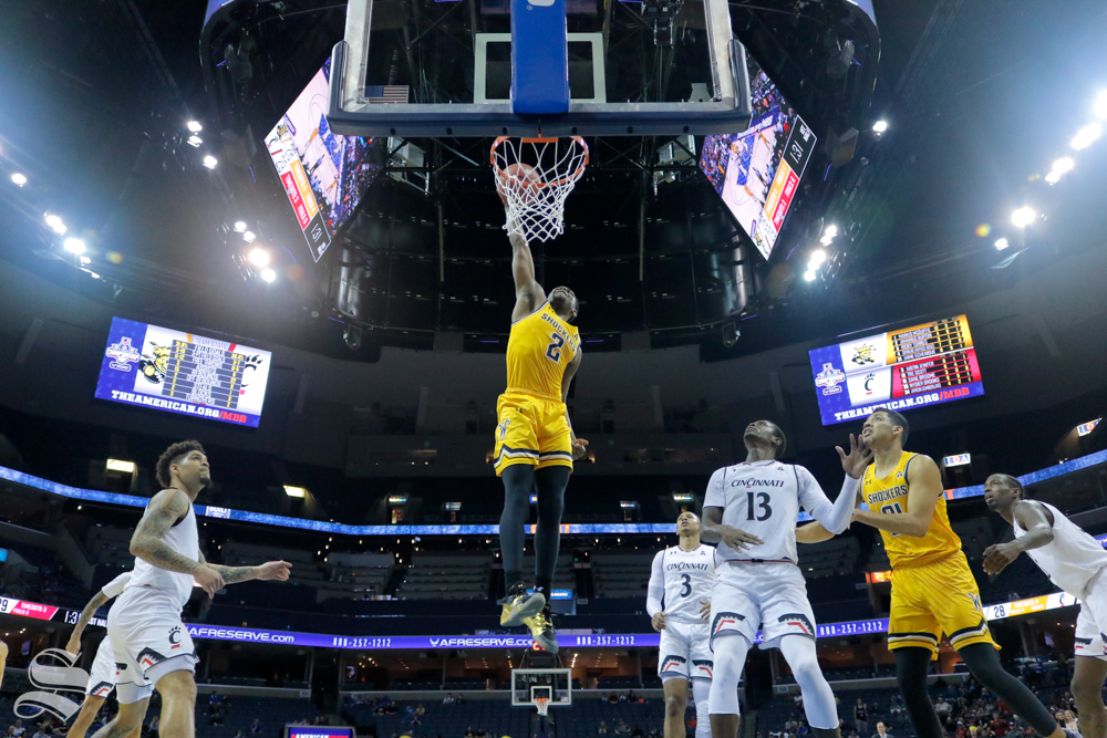Wichita State freshman Jamarius Burton dunks the ball during the first half of the game against Cincinnati on March 16, 2019 at the FedExForum in Memphis, Tennessee. (Photo by Joseph Barringhaus/The Sunflower).