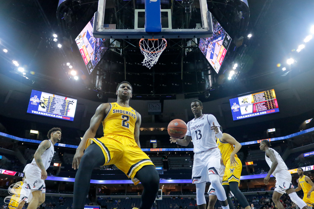 Wichita State freshman Jamarius Burton reacts to his dunk during the first half of the game against Cincinnati on March 16, 2019 at the FedExForum in Memphis, Tennessee. (Photo by Joseph Barringhaus/The Sunflower).