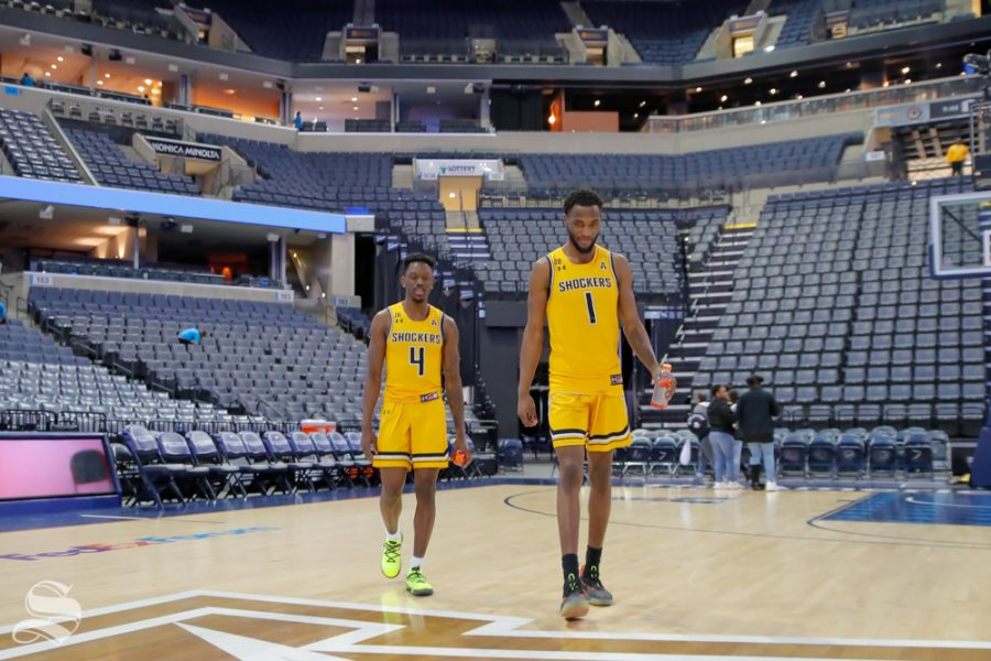 Wichita State seniors Markis McDuffie and Samajae Haynes-Jones walk back from the press conference. McDuffie and Haynes-Jones took a moment to take photos with fans before walking across the court in Memphis for the last time. (Photo by Joseph Barringhaus/The Sunflower).