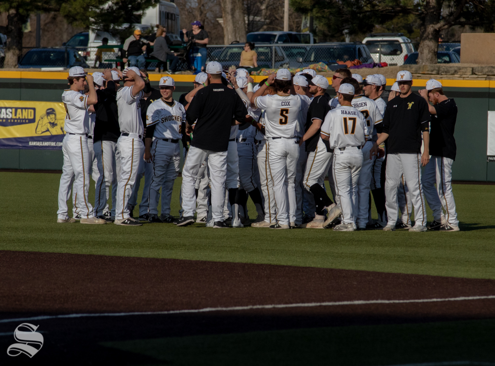 The Wichita State Baseball team prepares for their game against Kansas State on March 27 at Eck Stadium (Austin Shaw/The Sunflower.)