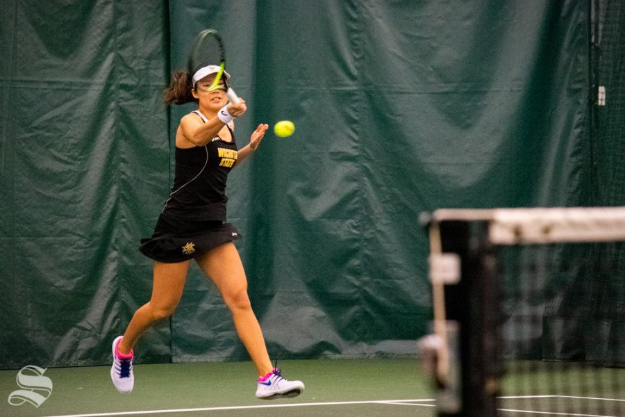 Wichita+State+sophomore+Lingwei+Kong+returns+a+serve+during+their+set+against+Oklahoma+State%27s+Lisa+Marie+Rioux.+Rioux+won+the+match+on+Sunday%2C+March+10+in+the+Wichita+Country+Club+tennis+complex.+%28Photo+by+Easton+Thompson%2FThe+Sunflower%29