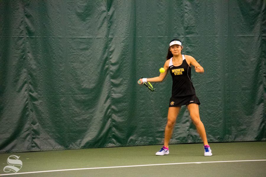 Wichita State sophomore Lingwei Kong returns the ball during their set against Oklahoma State's Lisa Marie Rioux. Rioux won the match on Sunday, March 10 in the Wichita Country Club tennis complex. (Photo by Easton Thompson/The Sunflower)