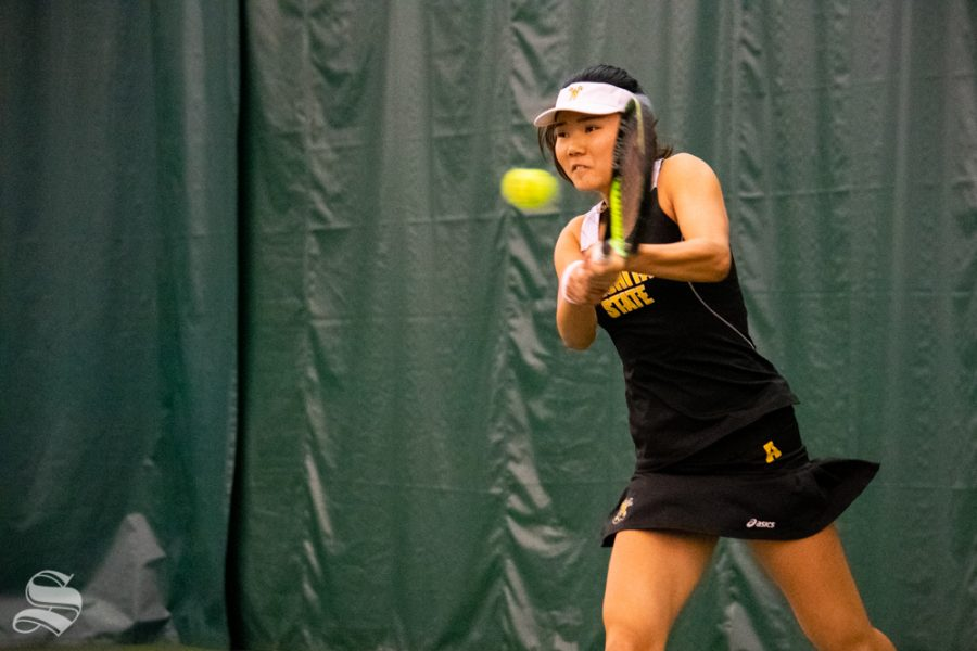 Wichita+State+sophomore+Lingwei+Kong+swings+for+the+ball+during+their+set+against+Oklahoma+State%27s+Lisa+Marie+Rioux+at+the+Wichita+Country+Club+tennis+complex+on+Sunday%2C+March+10.+%28Photo+by+Easton+Thompson%2FThe+Sunflower%29