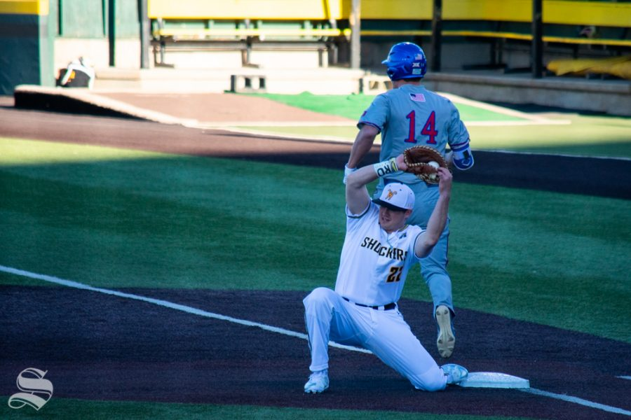 Wichita+State%27s+Mason+O%27Brien+catches+a+throw+to+get+out+Kansas+University%27s+Brett+Vosik+at+first+base+during+their+game+on+Wednesday%2C+March+20.+%28Photo+by+Easton+Thompson%2FThe+Sunflower%29.