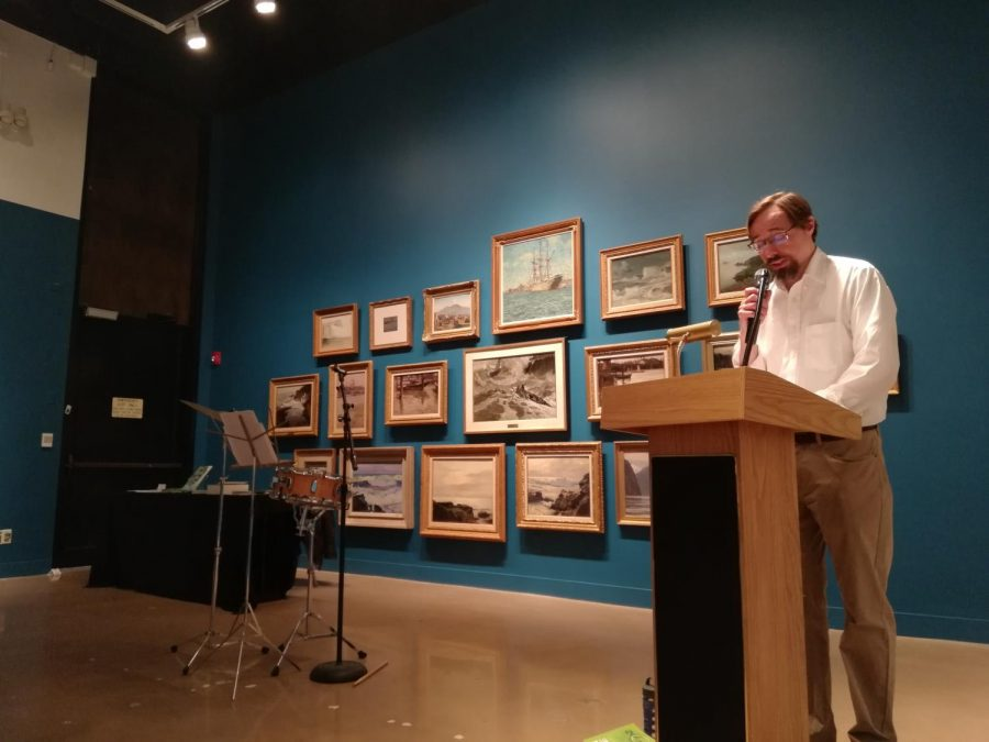 Kansas Poet Laureate Kevin Rabas reads his poetry at the Ulrich. His performance included jazz-infused poetry during which Rabas played percussive accompaniments to his writing.