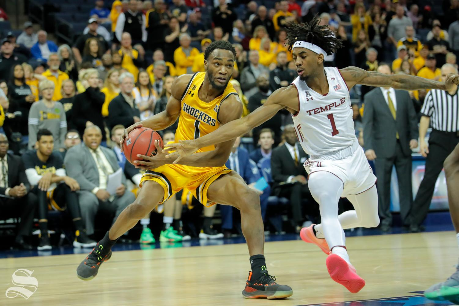 Wichita State's Markis McDuffie drives on Temple's Quinton Rose during the quarterfinals of the American Athletic Conference tournament. McDuffie scored a career-high in the game.