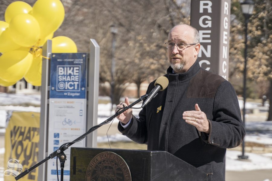 Wichita+Mayor+Jeff+Longwell+speaks+at+WSU+Bike+Share+ribbon+cutting+ceremony.+The+event+was+held+on+March+6%2C+2019+in+front+of+the+RSC.