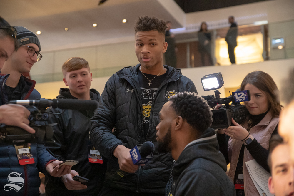 Wichita State freshman Dexter Dennis jokingly interviews senior Markis McDuffie in the New York Marriott Marquis on April 1, 2019. (Photo by Joseph Barringhaus/The Sunflower).