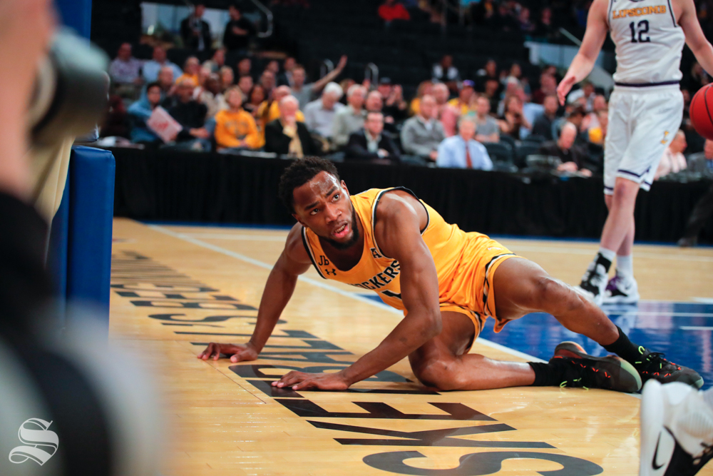 Wichita State senior Markis McDuffie lays on the ground after being fouled during the first half of the game against Lipscomb on April 2, 2019 at Madison Square Garden in New York. (Photo by Joseph Barringhaus/The Sunflower).
