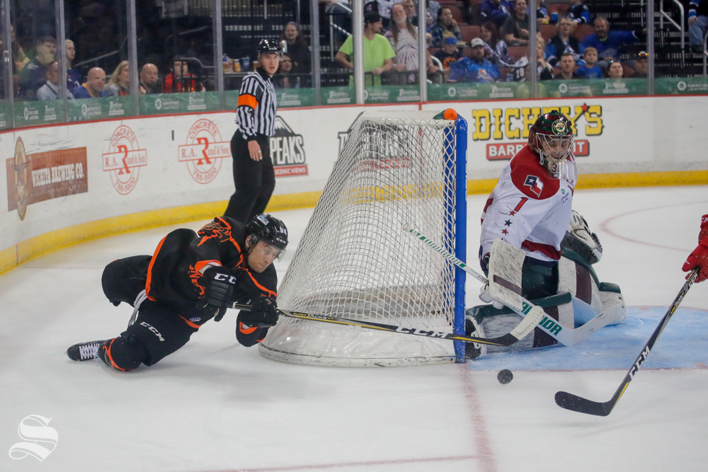 Wichita+Thunder+forward+Mark+MacMillan+wraps+the+puck+around+the+net+during+the+game+against+the+Allen+Americans+on+April+5%2C+2019+at+INTRUST+Bank+Arena.+%28Photo+by+Joseph+Barringhaus%2FThe+Sunflower%29.
