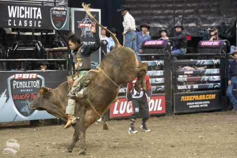 Garfield Wilson holds onto Betsy for 7.37 seconds during the first round of the PBR Pendleton Whisky Velocity Tour on April 13, 2019 at INTRUST Bank Arena. (Photo by Joseph Barringhaus/The Sunflower).