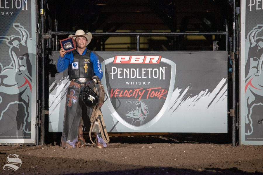Daylon Swearingen holds up his trophy after winning the PBR Pendleton Whisky Velocity Tour on April 13, 2019 at INTRUST Bank Arena. (Photo by Joseph Barringhaus/The Sunflower).