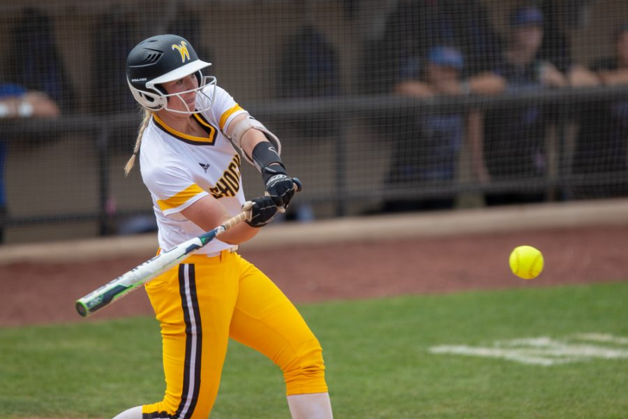Wichita State senior Laurie Derrico hits a home run during the game against Tulsa on April 27, 2019 at Collins Family Softball Complex in Tulsa, Oklahoma. Derrico's 39th home run tied the record for most home runs by a Wichita State player. (Photo by Joseph Barringhaus/The Sunflower).