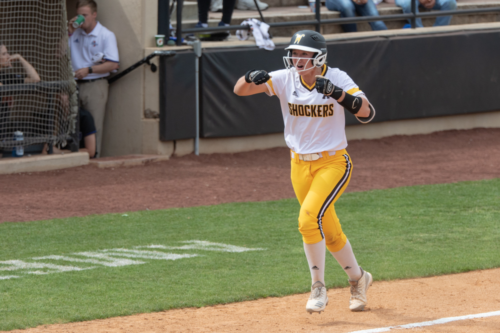 Wichita+State+senior+Laurie+Derrico+runs+home+after+hitting+a+home+run+during+the+game+against+Tulsa+on+April+27%2C+2019+at+Collins+Family+Softball+Complex+in+Tulsa%2C+Oklahoma.+Derrico%27s+39th+home+run+tied+the+record+for+most+home+runs+by+a+Wichita+State+player.+%28Photo+by+Joseph+Barringhaus%2FThe+Sunflower%29.