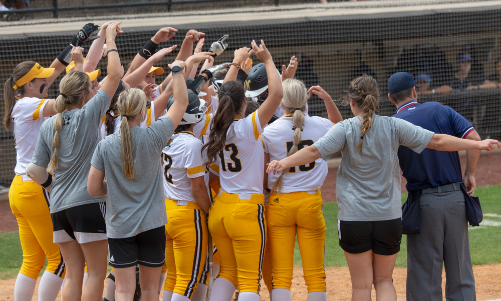 Wichita+State+senior+Laurie+Derrico+celebrates+at+home+after+hitting+a+home+run+during+the+game+against+Tulsa+on+April+27%2C+2019+at+Collins+Family+Softball+Complex+in+Tulsa%2C+Oklahoma.+Derrico%27s+39th+home+run+tied+the+record+for+most+home+runs+by+a+Wichita+State+player.+%28Photo+by+Joseph+Barringhaus%2FThe+Sunflower%29.